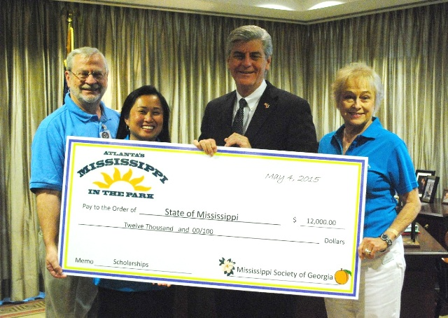 Society presents check to governor