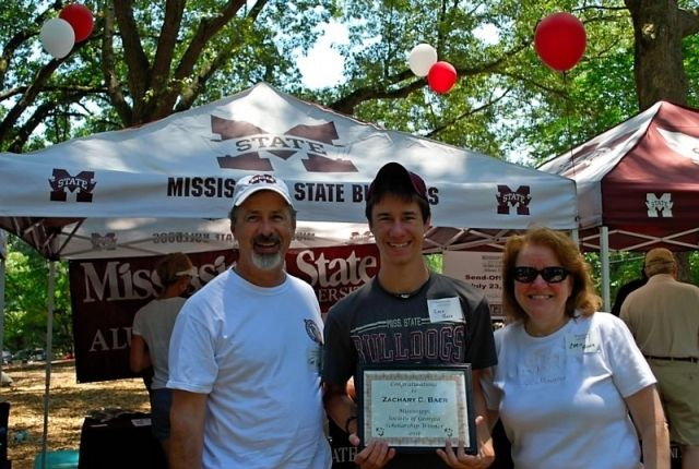 2011 scholarship winner Zachary Baer with parents