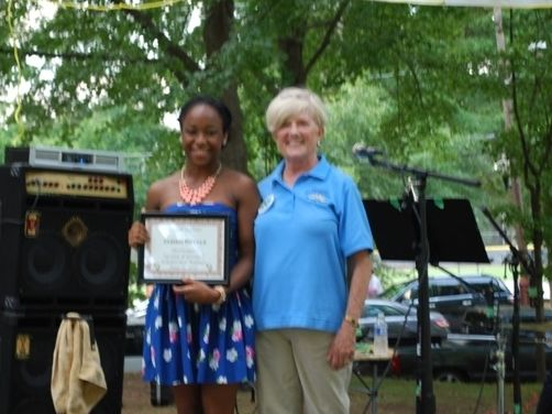 Jasmin Revels accepting the 2013 scholarship